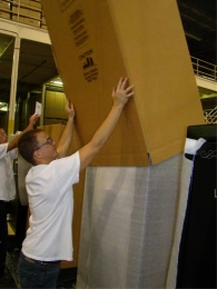 Heavy-duty corrigated box covers the foam for shipping