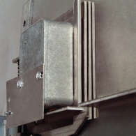 Triple layered hardplates protect lock