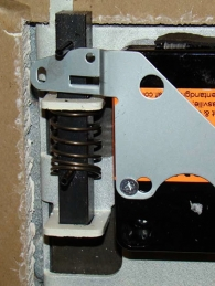 Spring-loaded external relocker connected to back cover of lock